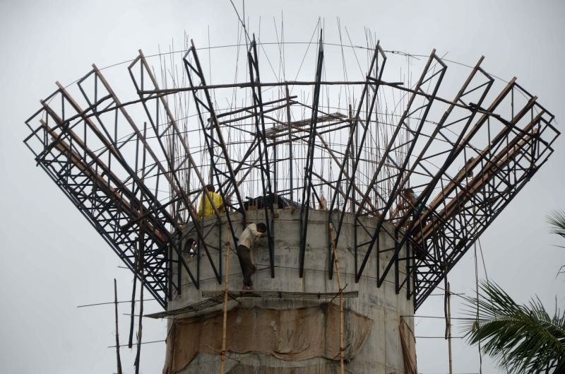 Workers busy in the construction of a water tank, without safety equipments, in Mumbai on July 18, 2018.