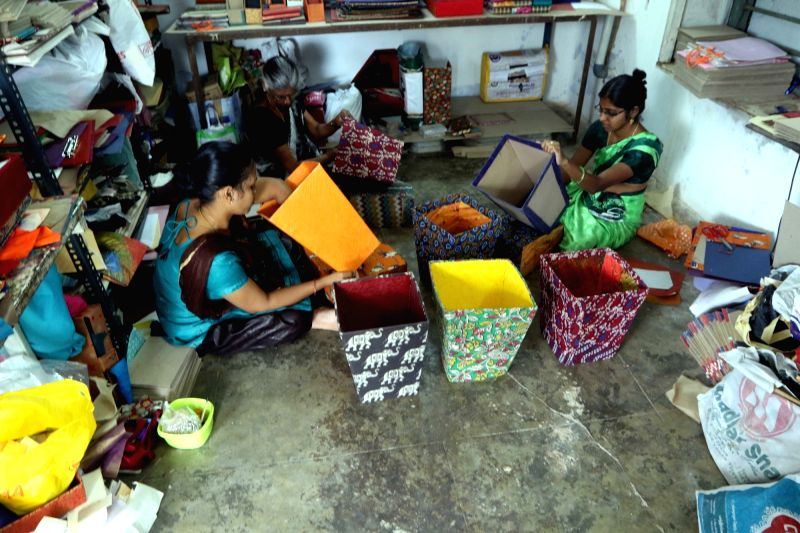 Workers busy making cardboard dustbins ahead of a plastic ban announced by the Tamil Nadu government, in Chennai on July 16, 2018. The state government recently issued orders that exempted ...