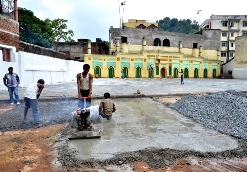 Workers busy preparing an `Eidgah` before Eid ul-Fitr in Ranchi on July 27, 2014.
