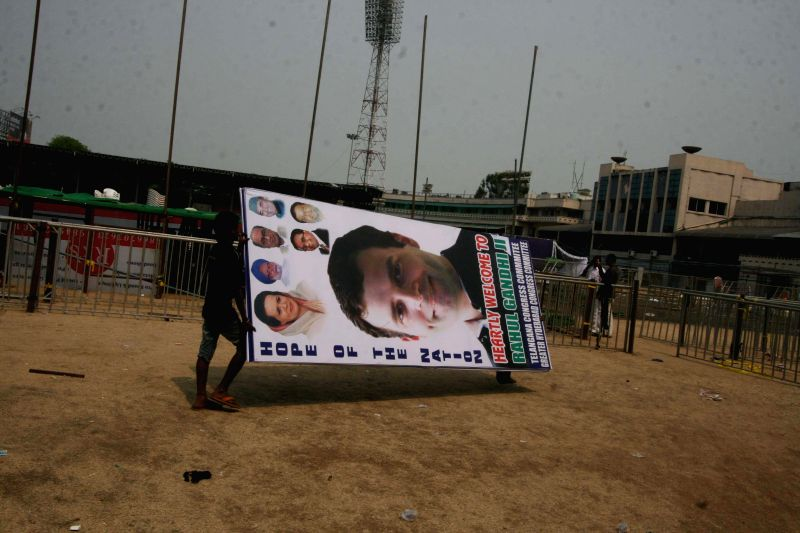 Workers carry a hoarding of Congress vice president Rahul Gandhi at the Lal Bahadur Shastri Stadium in Hyderabad on April 24, 2014, a day ahead of Congress vice president Rahul Gandhi's scheduled ...