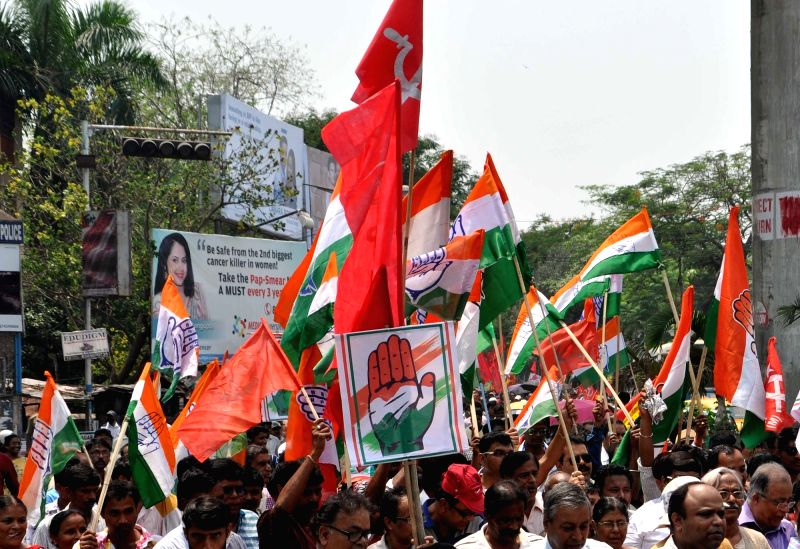 Workers of Congress and Left parties during an election campaign ahead of West Bengal Assembly polls in Kolkata, on April 6, 2016.