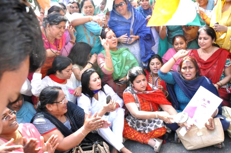 Workers of Delhi Mahila Congress led by DPMC chief Dr. Onika Mehrotra stage a demonstration against BJP Prime Ministerial candidate and Gujarat Chief Minister Narendra Modi in New Delhi on April 11, .