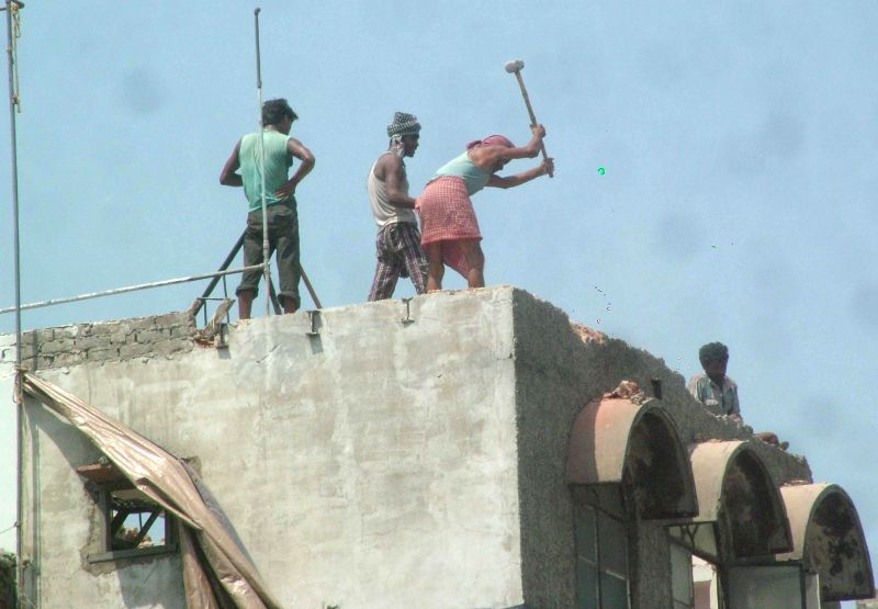 Workers of Municipal Corporation of Delhi raze shops in Azad Market for construction of the Rani-Jhansi grade separator in New Delhi on Aug 27, 2014.