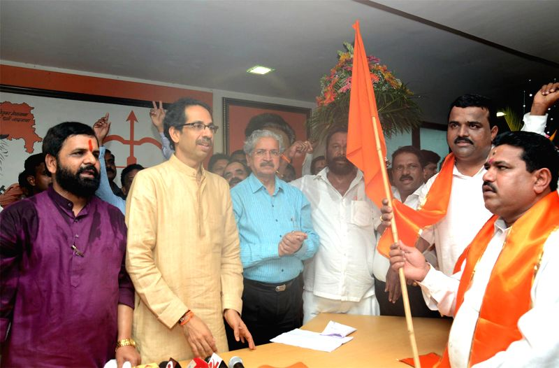 Workers of Shetkari Kamgar Paksha of Raigad district join Shiv Sena in presence of Shiv Sena chief Uddhav Thackeray in Mumbai on July 9, 2014.
