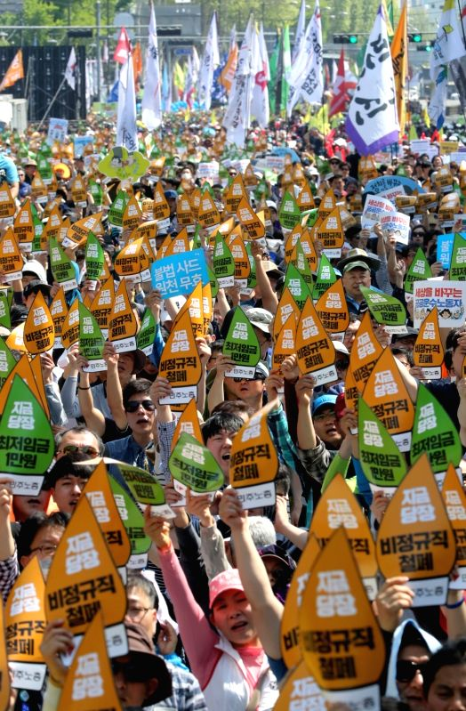 Workers shout slogans during a rally in Seoul on May 1, 2017, to mark the Labor Day holiday that fell on the same day.