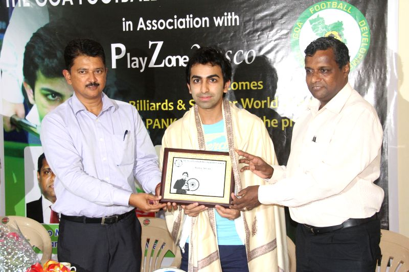 World Billiards Champion Pankaj Advani being felicitated by Goa Football Development Corporation President Dr Roufin Monteiro and Goa Football Association Vice President Elvis Gomes in Panaji on ...