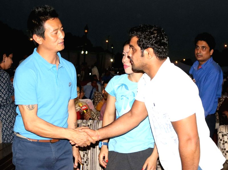 """Wrestler Sushil Kumar, footballer Baichung Bhutia and boxer Mary Kom at the """"OORJA"""" by CAPF U-19 Football talent hunt tournament 2017 for boys and girls at the backdrop of India ... - Mary Kom and Sushil Kumar"""