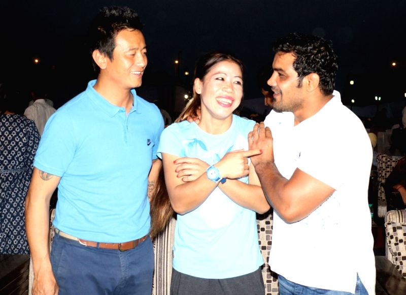 "Wrestler Sushil Kumar, footballer Baichung Bhutia and boxer Mary Kom at the ""OORJA"" by CAPF U-19 Football talent hunt tournament 2017 for boys and girls at the backdrop of India ... - Mary Kom and Sushil Kumar"