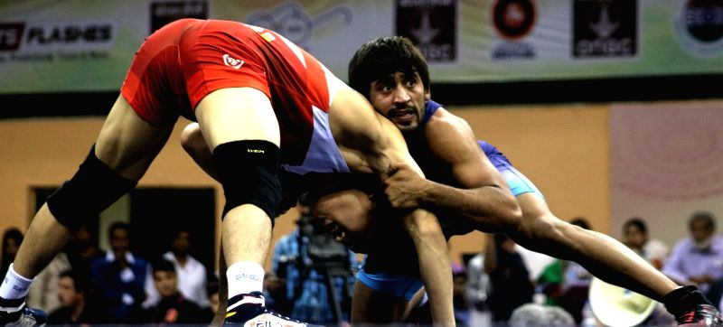 Wrestlers Bajrang Punia of India and Korea's Seungchul Lee in action during the final match of 65 kg Asian Wrestling Championship in New Delhi, on May 13, 2017.