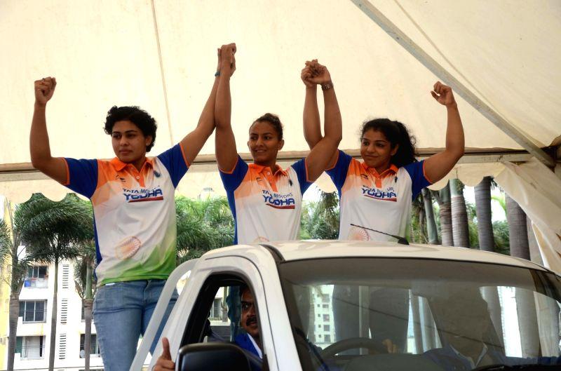 Wrestlers Sakshi Malik, Pooja Dhanda and Geeta Phogat during 'Tata Yodha'- Wrestling Federation of India press conference, in Mumbai on Aug 1, 2018. - Malik