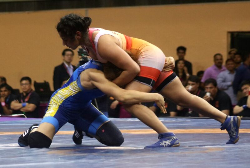 Wrestlers Sarita of India and Kyrgyzstan's Aisuluu Tynybekova in action during the match of 58 kg Asian Wrestling Championship in New Delhi, on May 13, 2017.