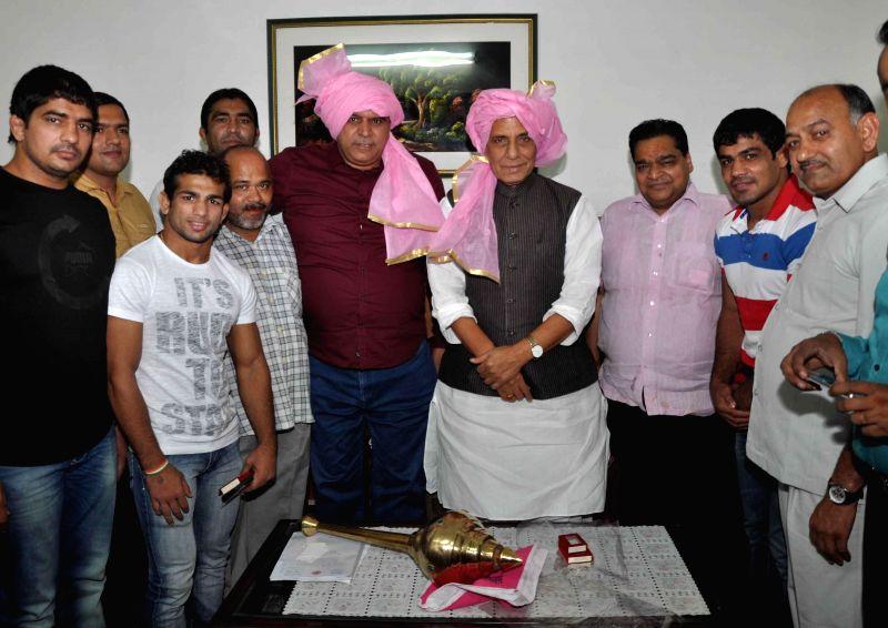 Wrestlers Sushil Kumar, Amit Dahiya and Rajiv Tomar with Union Home Minister Rajnath Singh at his residence in New Delhi on Aug 3, 2014. Sushil Kumar and Amit Dahiya won gold medals while  Rajiv ... - Sushil Kumar