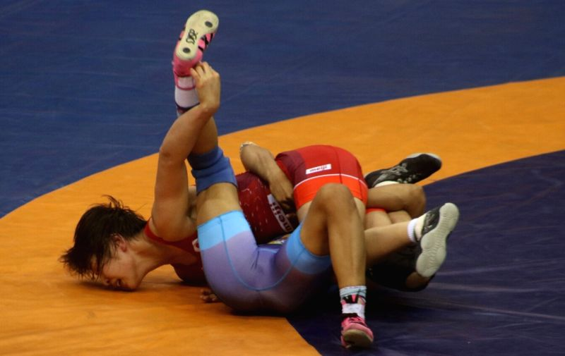 Wrestlers Vinesh of India and Japan's Sae Nanjo in action during the final match of 55 kg Asian Wrestling Championship in New Delhi, on May 12, 2017.