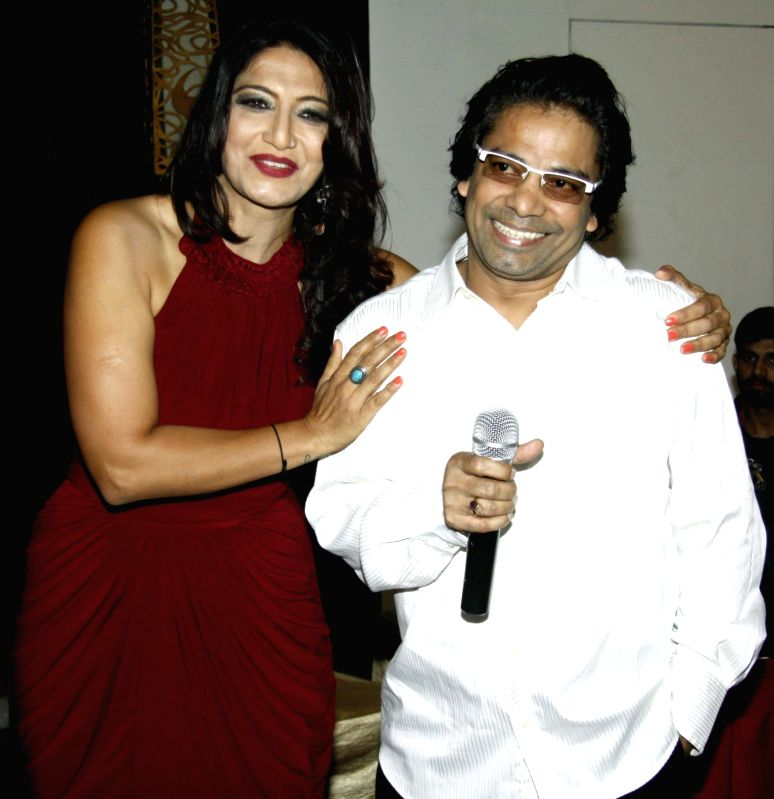 Writer Aarti Nagpal and Laungi during the party to celebrate Aarti winning Dadasaheb Phalke Award in Mumbai on July 26, 2016.