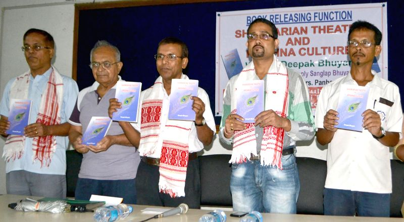 Writer Ismail Hussain and other dignitaries release Deepak Bhuyan's book  `Shankarian theater and Krishna Culture` at Guwahati Press Club on July 31, 2014.