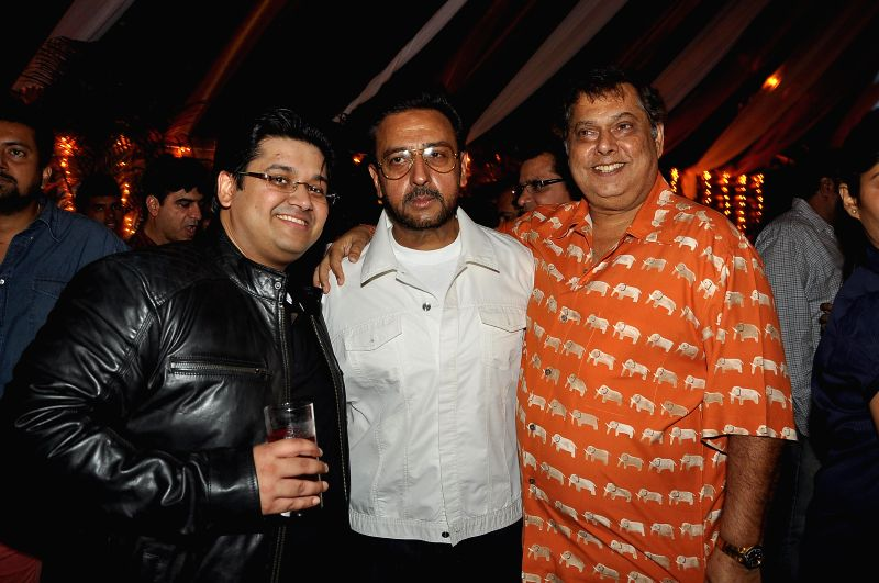 Writer Milap Zaveri with actor Gulshan Grover and filmmaker David Dhavan during a success party hosted by Sanjay Gupta to celebrate the success of the films 'Main Tera Hero', 'Grand Masti' and ... - Gulshan Grover and Sanjay Gupta