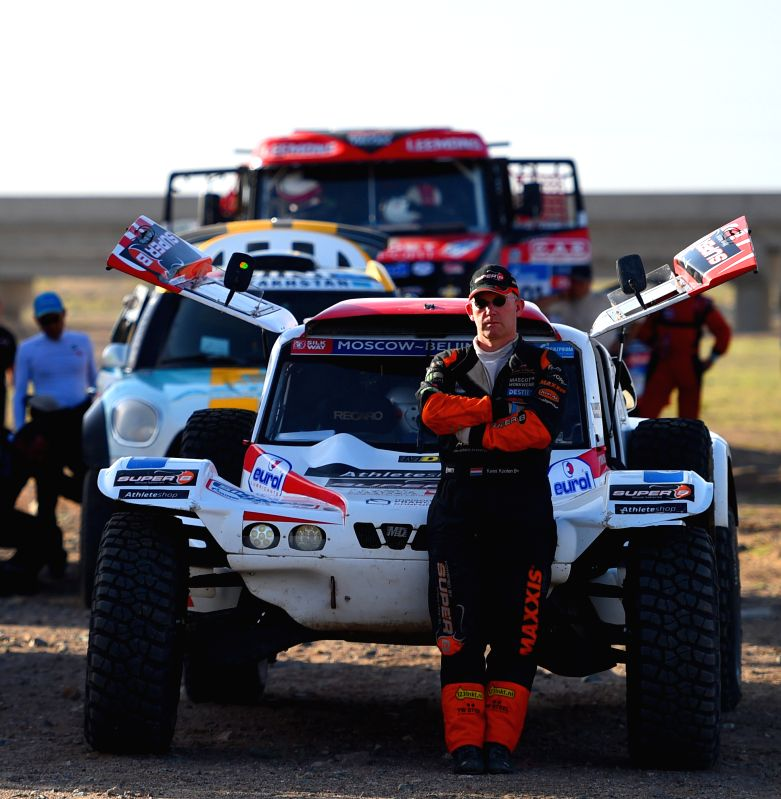 WUHAI, July 22, 2016 - MD Rallye Sport's driver Cornelis Koolen poses prior to the 13th stage of the Silkway Rally 2016 in Alashan Right Banner, north China's Inner Mongolia Autonomous Region, on ...