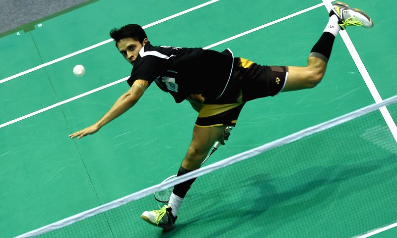 Kashyap Parupalli of India returns the shuttlecock to Zi Liang Derek Wong of Singapore during the men's singles first round match at the Asian Badminton ...