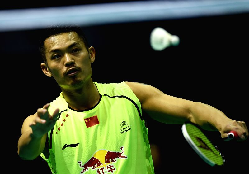 China's Lin Dan returns a shot during the men's singles match against Iran's Farzin Khanjani at the Asian Badminton Championships 2015 in Wuhan, capital of central ...