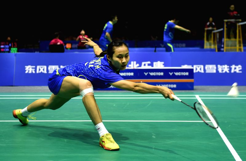 China's Wang Yihan returns a shot during the women's singles match against Indonesia's Maria Febe Kusumastuti at the Asian Badminton Championships 2015 in Wuhan, ...