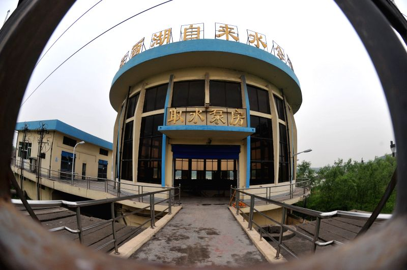 The door of a station for water-getting in the Yushidun water plant is closed in Wuhan, capital of central China's Hubei Province, April 24, 2014. Two major water ...