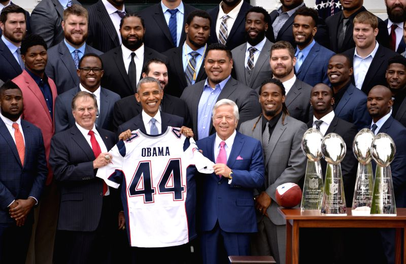 U.S. President Barack Obama (front C) poses for photos with New England Patriots at a ceremony honoring the Super Bowl Champion New England Patriots on the South ...