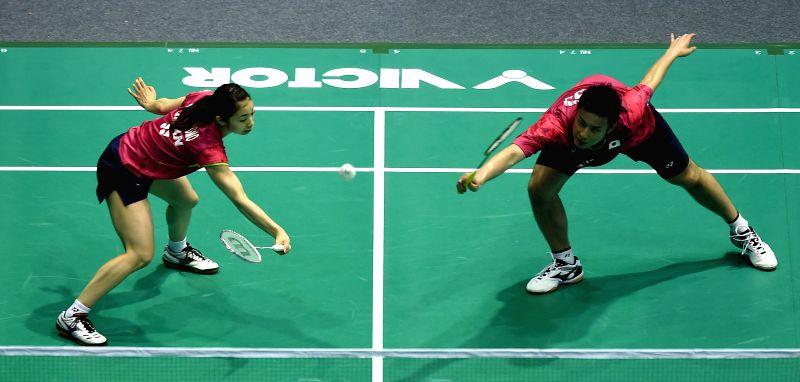 Kenichi Hayakawa/Misaki Matsutomo (L) of Japan compete during the mixed doubles semi-final match against Lee Chun Hei/Chau Hoi Wah of China's Hong Kong at the Asian ...