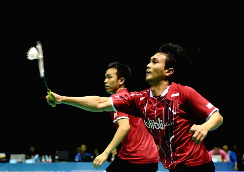 Mohammad Ahsan (R) and Hendra Setiawan of Indonisia compete during the men's doubles final of Dong Feng Citroen Badminton Asia Championships 2015 in Wuhan, China, on ...