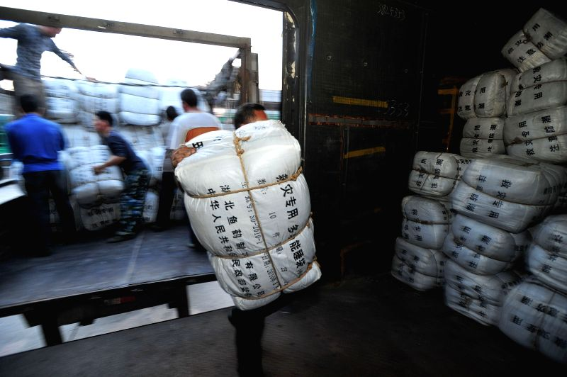 People transport relief materials to a train in Wuhan, capital of central China's Hubei Province, April 26, 2015. Death toll in southwest China's Tibet Autonomous ...