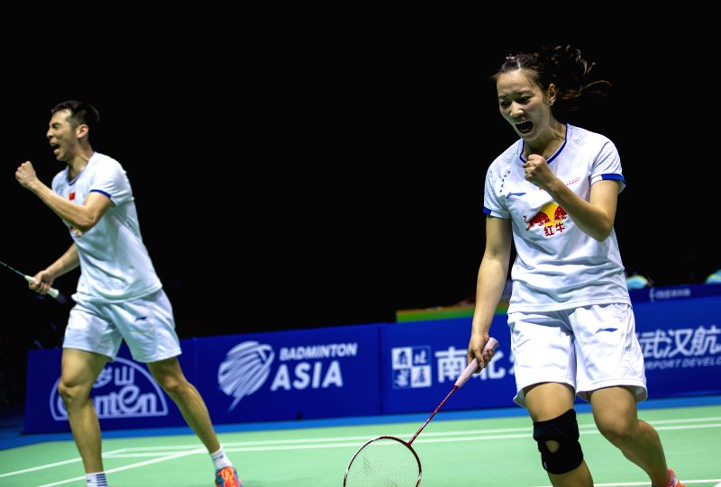 WUHAN, April 30, 2017 - Lu Kai (L) and Huang Yaqiong of China celebrate during the mixed doubles final against Thailand's Dechapol Puavaranukroh and Sapsiree Taerattanachai at the Badminton Asia ...