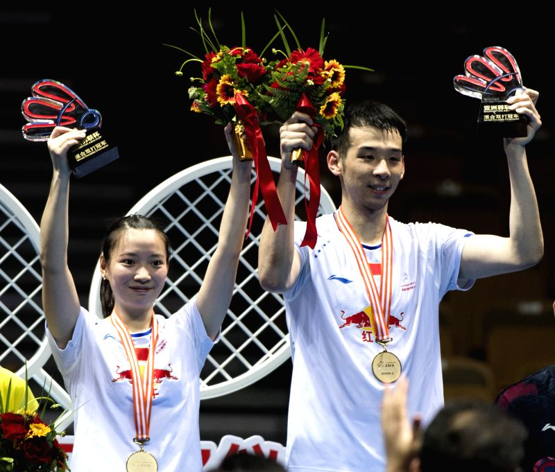 WUHAN, April 30, 2017 - Lu Kai (R) and Huang Yaqiong of China celebrate during the awarding ceremony for the mixed doubles final at the Badminton Asia Championships 2017 in Wuhan, capital of central ...