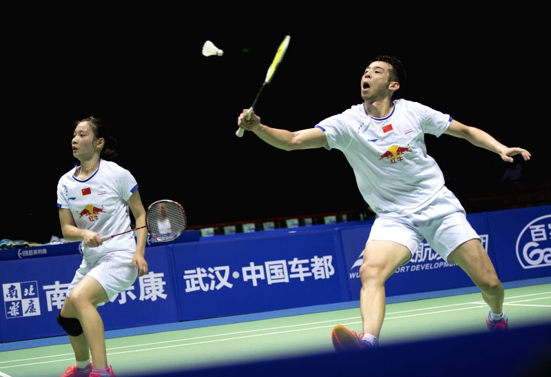 WUHAN, April 30, 2017 - Lu Kai (R) and Huang Yaqiong of China compete during the mixed doubles final against Thailand's Dechapol Puavaranukroh and Sapsiree Taerattanachai at the Badminton Asia ...