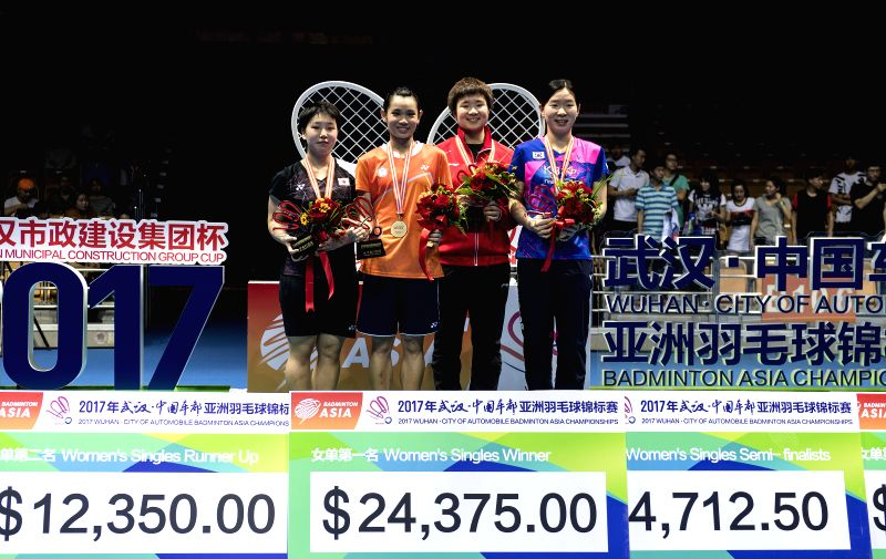 WUHAN, April 30, 2017 - Winner Tai Tzu Ying (2nd L) of Chinese Taipei, runner-up Japan's Yamaguchi Akane (1st L) and third-place-winners China's He Bingjiao (2nd R) and South Korea's Lee Jang Mi pose ...