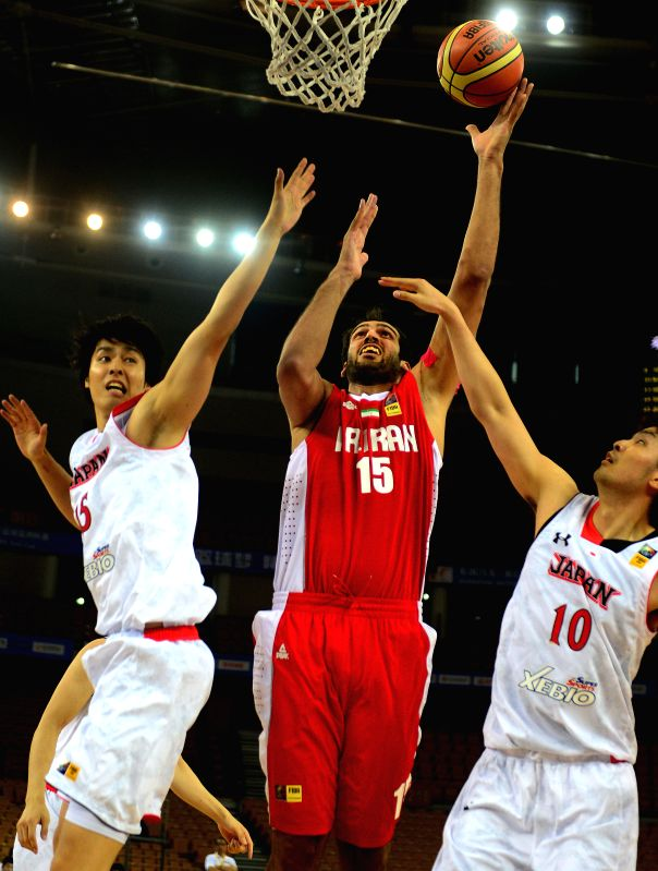 Iran's Ehadadi Hamed (C) goes up for a shot during the match between Iran and Japan at the 5th FIBA Asia Cup basketball tournament in Wuhan, capital of central ...
