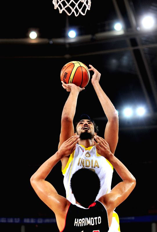 India's Mohammad Jamshidi(Top) tries to shoot as Japan's Tenketsu Harimoto defends during the match between Japan and India in the 5th FIBA Asia Cup basketball ...