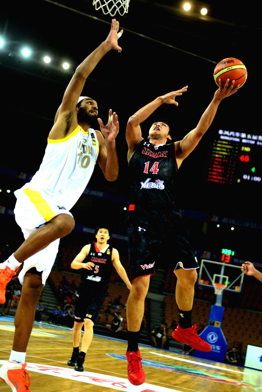 Japan's Tenketsu Harimoto(R) goes up for a shot during the match between Japan and India in the 5th FIBA Asia Cup basketball tournament in Wuhan, capital of central ..