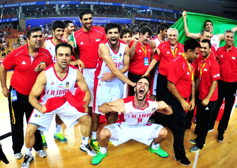 Players of Iran celebrate after the final match against Chinese Taipei in the 5th FIBA Asia Cup basketball tournament in Wuhan, capital of central China's Hubei ...