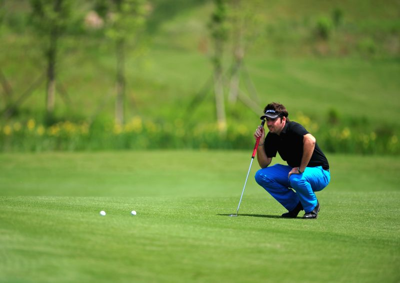 Alexander Hawley of Australia competes in the 2014 China Tour-PGA Tour China Series Wuhan Open in Wuhan, capital of central China's Hubei Province, May 15, 2014. ...