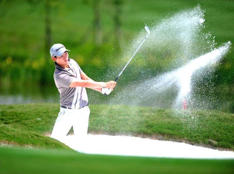 Kim Seong of the United States competes in the 2014 China Tour-PGA Tour China Series Wuhan Open in Wuhan, capital of central China's Hubei Province, May 15, 2014. ...