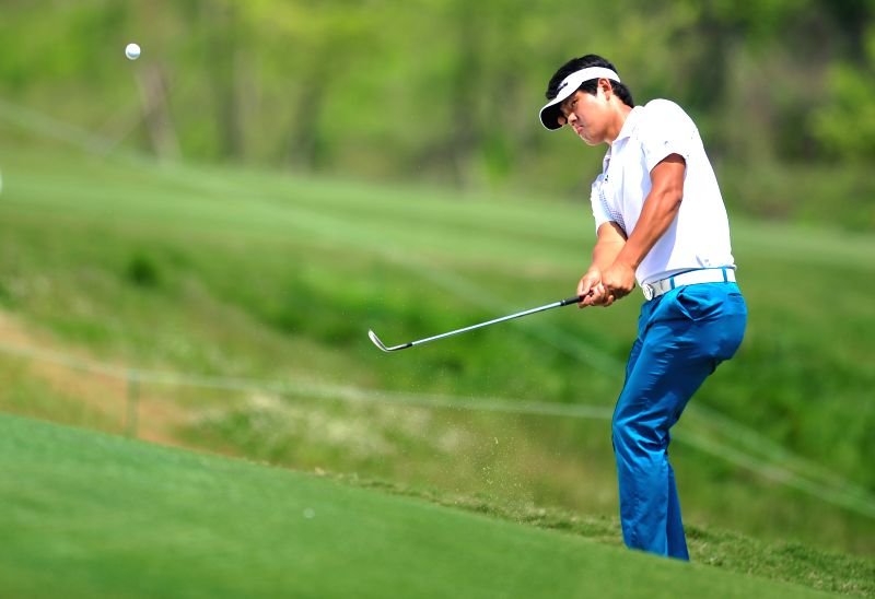 Lee Seongki of South Korea competes in the 2014 China Tour-PGA Tour China Series Wuhan Open in Wuhan, capital of central China's Hubei Province, May 15, 2014. ...