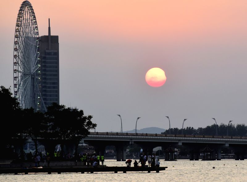 WUXI, Aug. 11, 2018 - Photo taken on Aug. 11, 2018 shows the sun going through a partial solar eclipse in Wuxi City, east China's Jiangsu Province.