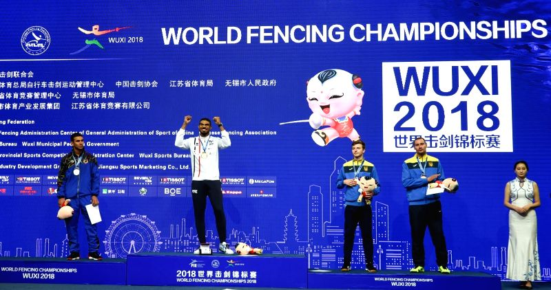 WUXI, July 23, 2018 - Yannick Borel of France, Limardo Gascon of Venezuela, Roman Svichkar and Bogdan Nikishin of Ukraine attend the awarding ceremony for men's epee final at the Fencing World ...