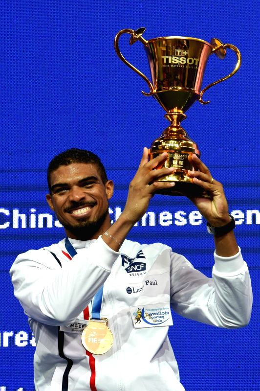 WUXI, July 23, 2018 - Yannick Borel of France poses with the trophy during the awarding ceremony for men's epee final at the Fencing World Championships in Wuxi, east China's Jiangsu Province, July ...