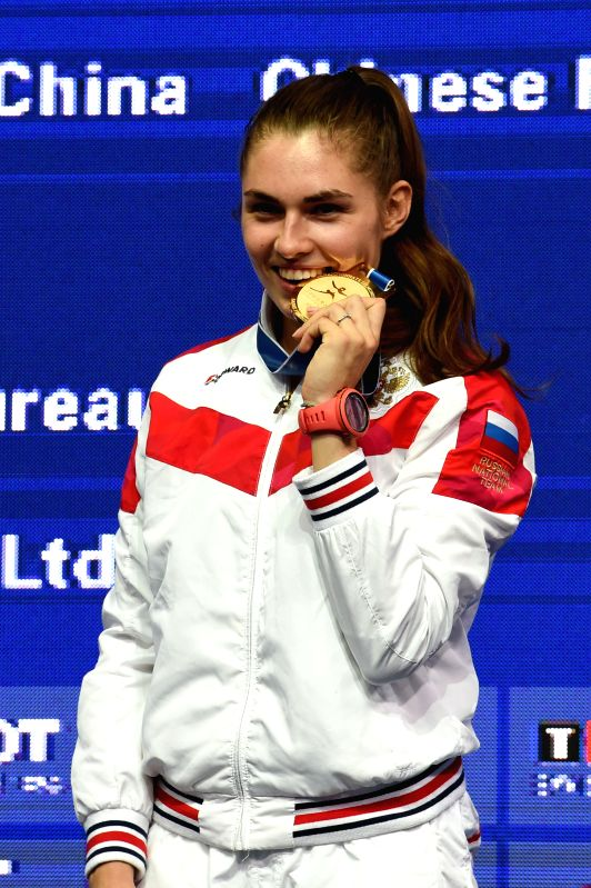 WUXI, July 24, 2018 - Sofia Pozdniakova of Russia poses for photos during the awarding ceremony after the women's sabre final match against Sofya Velikaya of Russia at the Fencing World Championships ...