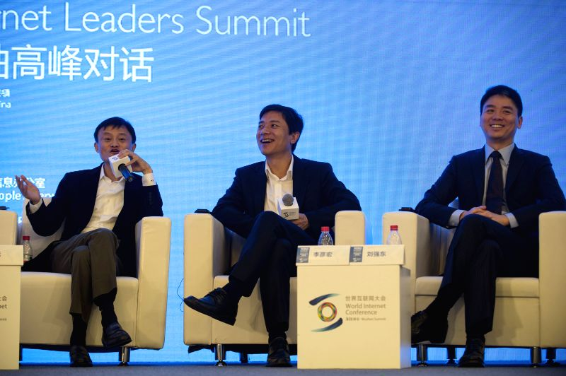Ma Yun (L), founder and chairman of China's leading e-commerce company Alibaba Group, Co-founder, Chairman and CEO of Chinese search engine Baidu Li Yanhong (C), and Liu Qiangdong (R), CEO of