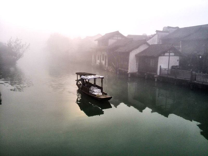 Photo taken on Nov. 20, 2014 shows a view of Wuzhen, a historic water town in east China's Zhejiang Province. The World Internet Conference is held in Wuzhen from Nov. 19-21. (Xinhua/Xu ...