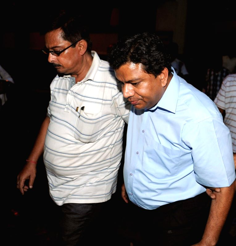 Xenitis chairman Shantanu Ghosh being taken to be produced in a Kolkata court in connection with Sardha chit fund scam on June 25, 2014.
