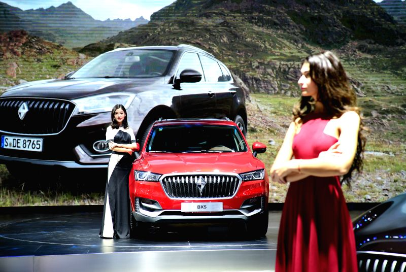 XI'A model presents a Borgward car at an auto show in Xi'an, capital of northwest China's Shaanxi Province, April 28, 2017.