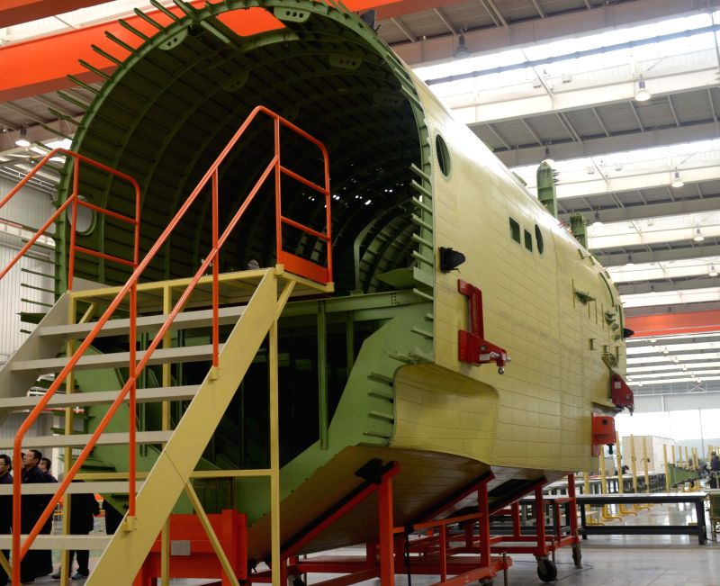 XI'Photo taken on Dec. 29, 2014 shows the fuselage mid-section of China's self-developed amphibious aircraft AG600 at the Aviation Industry Corporation of China (AVIC) ..