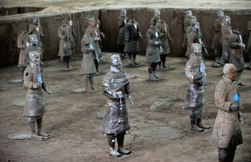 XI'Photo taken on Feb. 27, 2015 shows terracotta warriors wrapped in cling film for color fixing at the Emperor Qinshihuang's Mausoleum Site Museum in Xi'an, capital of ...
